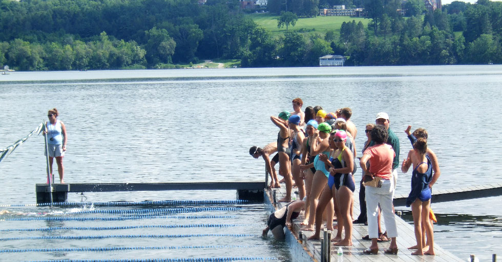 Swimmers ready to jump of the dock of the grove